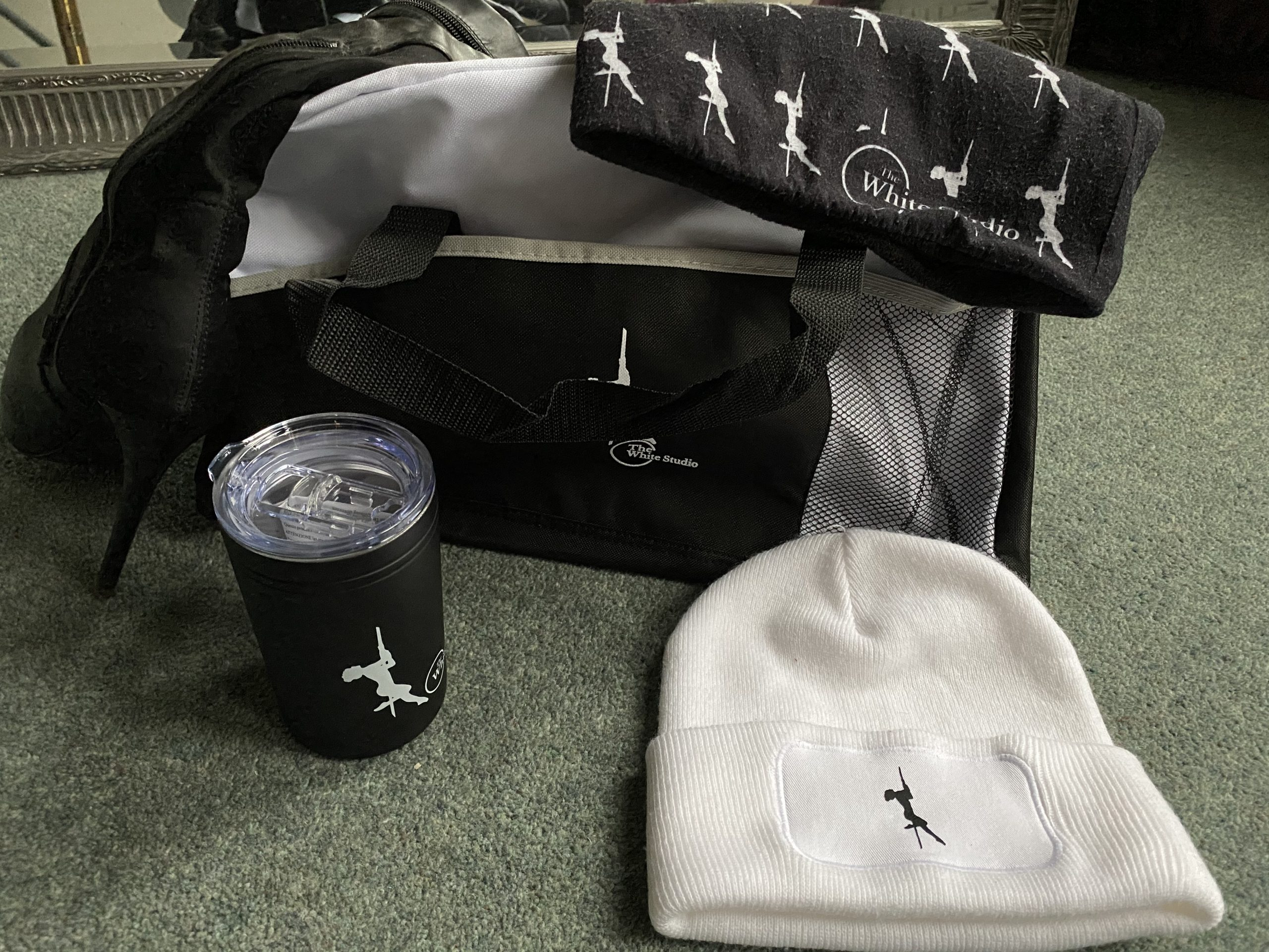 Duffel bag shown against other items, for size comparison.